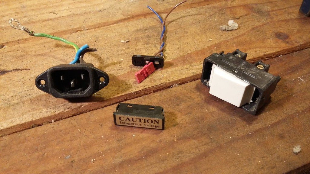 Socket removed, turns out that label was actually the 110v/240v switch covered up. Also found a mains rated switch which might be suitable for the box