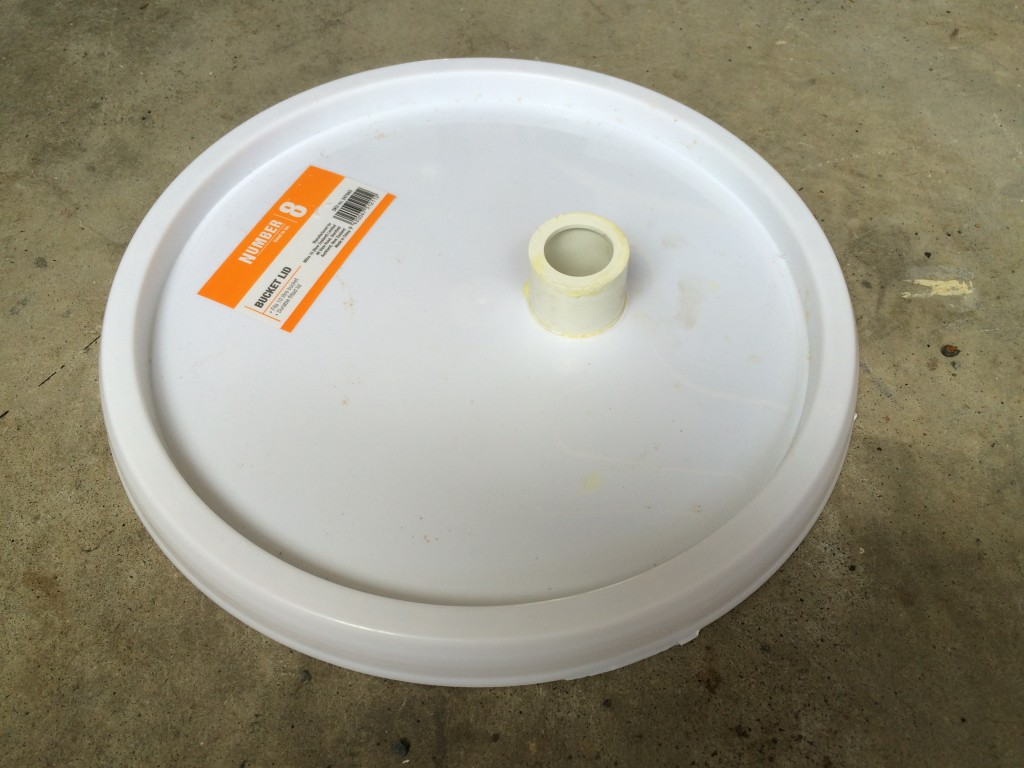 PVC attachment glued into bucket lid