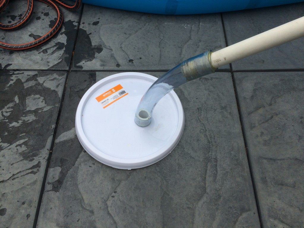 Pool cleaner bucket lid attachment